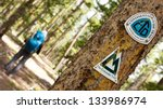 Continental Divide Trail and Colorado Trail Signs on a Tree