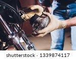 man fixing bike. confident... | Shutterstock . vector #1339874117