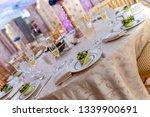 wedding banquet table setting    Shutterstock . vector #1339900691