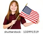 Young caucasian girl holding an American Flag - stock photo