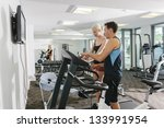attractive couple working out... | Shutterstock . vector #133991954