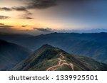 View of Dinosaur backbone Ta Xua, Bac Yen, Son La, Vietnam. Sunrise, mountain hill path road panoramic landscape