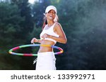 Woman Rotates Hula Hoop On...