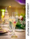 glass on wedding banquet table    Shutterstock . vector #1339958807