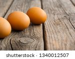 three eggs on weathered wooden... | Shutterstock . vector #1340012507