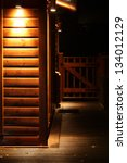 Spot Light Lodge At Night With...
