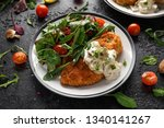 chicken steak in breadcrumbs... | Shutterstock . vector #1340141267