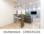 modern dining room with bar... | Shutterstock . vector #1340151131