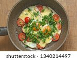 fresh fried eggs are cooked in... | Shutterstock . vector #1340214497