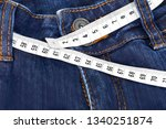 jeans and measuring tape sixty... | Shutterstock . vector #1340251874