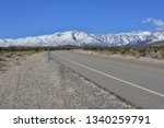 A Desert Road Leading To Moun...