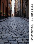 old cobbled narrow street with...   Shutterstock . vector #1340511161