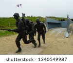 Small photo of Utah Beach, Normandy / France - 06 06 2018 : soldier statues at Utah Beach depicting D Day landing during Operation Overlord in World War 2 in 6th June 1944, memorial to war heroes in Normandy, Europe