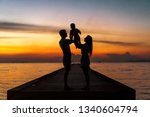 family in love with son hugging ... | Shutterstock . vector #1340604794