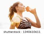 closeup of beautiful fitness... | Shutterstock . vector #1340610611