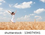 Happy Woman Jumping In Golden...