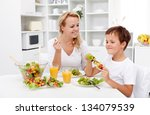woman and little boy having a...