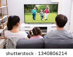 rear view of parents sitting... | Shutterstock . vector #1340806214