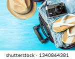 open suitcase with travel... | Shutterstock . vector #1340864381