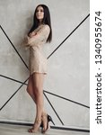 alluring model in beige laced... | Shutterstock . vector #1340955674