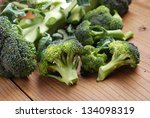 Green Broccoli On Wood Table