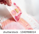 hand holding chinese yuan... | Shutterstock . vector #1340988014