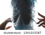 Small photo of Choke. Women with blue plastic bag over his head is suffocating. Suffocation. Copy space for text.