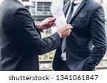 businessman giving money in... | Shutterstock . vector #1341061847