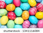 colorful easter eggs on blue... | Shutterstock . vector #1341116084