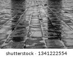 wet street cobbles   Shutterstock . vector #1341222554