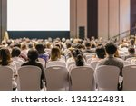 rear view of audience listening ... | Shutterstock . vector #1341224831