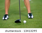 lady golfer practicing at driving range - stock photo
