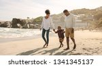 family of three taking a walk... | Shutterstock . vector #1341345137