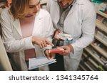 female chemist with... | Shutterstock . vector #1341345764