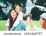 happy asian girls having fun... | Shutterstock . vector #1341360797