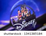 Small photo of Brest, Belarus, March 15, 2019. The home page of the Disney site, view through a magnifying glass. Disney company logo is visible. Soft focus.