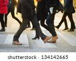 Pedestrians on zebra crossing - stock photo
