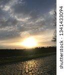 sundown with street | Shutterstock . vector #1341433094