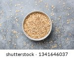 rolled oats or oat flakes in... | Shutterstock . vector #1341646037