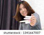 woman hands holding ovulation... | Shutterstock . vector #1341667007