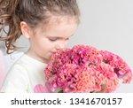 Closeup Of Little Girl Smellin...
