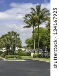 Traditional gated community road in Naples, South Florida - stock photo