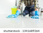 man with cloth cleaning floor... | Shutterstock . vector #1341689264