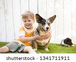 a five year old boy hugs a... | Shutterstock . vector #1341711911