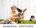 a five year old boy hugs a... | Shutterstock . vector #1341711914