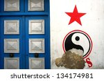 Blue door and red star in Tunisia - stock photo