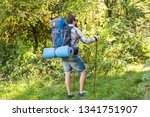 Stock photo adventures summer tourism and nature concept tourist arriving to a camping with his cat 1341751907