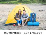 Stock photo people tourism and nature concept couple having fun on camping trip and play with cat 1341751994