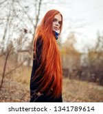 woman with long red hair walks... | Shutterstock . vector #1341789614