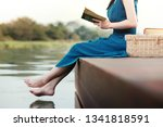 young woman relaxing by... | Shutterstock . vector #1341818591